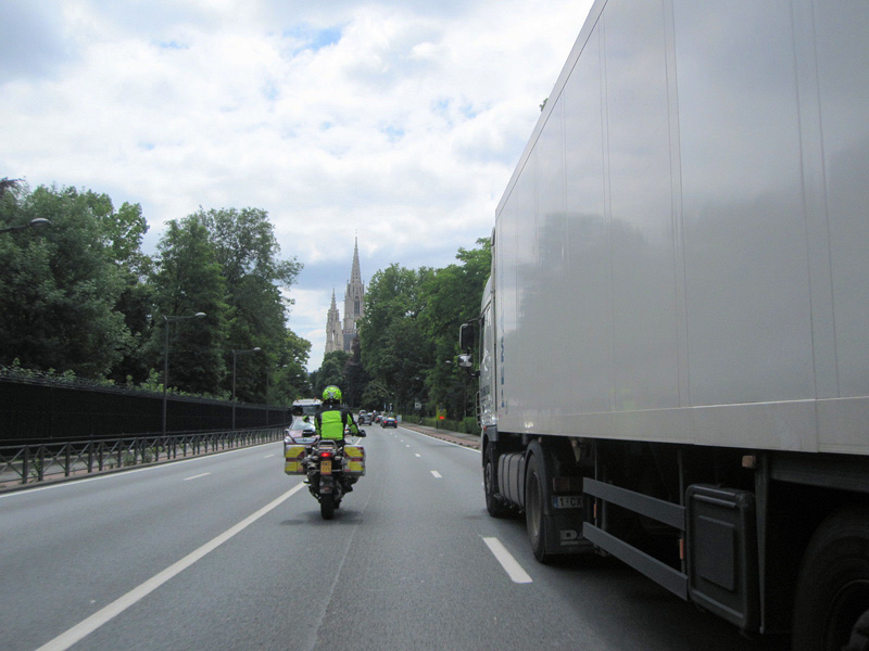 motorcycle next to 18 wheeler first stop